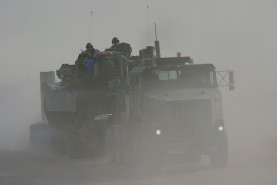 Marines from tank section attached to 24 MEU in convoy north from Kuwait to Iraq, July 2004