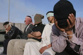 Iraqi men detained for alleged possession of illegal weapons and planning attacks on US forces, Forward Operating Base Iskandariyah, January 2005